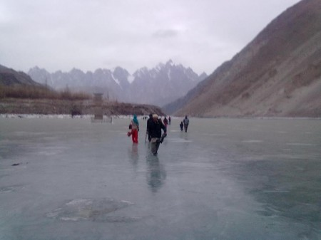 Gulmit: People are crossing the dammed river