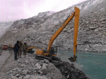 Attabad: An excavator machine working at the spillway. Photo taken on January 14, 2013