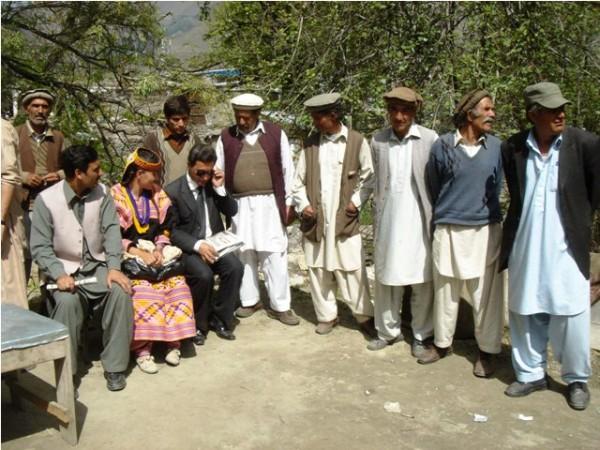 Representatives of the Kalash community talking to the media