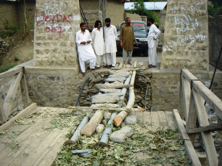 Jughor: Local people trying to re-link a bridge connecting the village with Chitral town