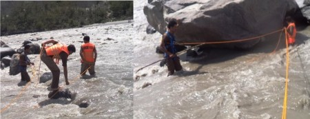 Workers of Rescue 1122 searching in the Gilgit river for the missing woman