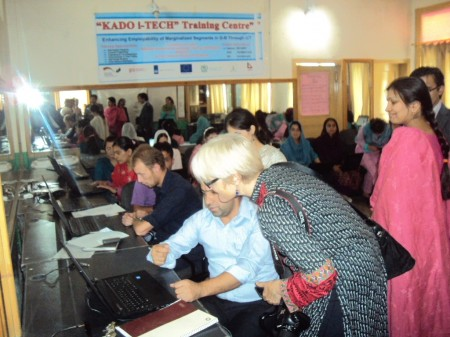 A visitor talks to the students at an ICT center established by KADO