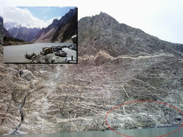 In these file photos the cars and cabins can be seen parked a the toe of the huge mountain (in red circle) . PT Photos