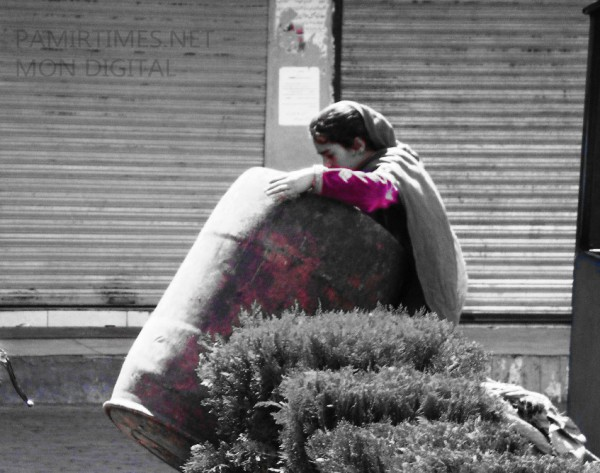 A young girl search a trash drum to find something valuable. A large number of the street children in Gilgit are non-locals, who come to the city with their families during the summers. Photo: Mon Digital