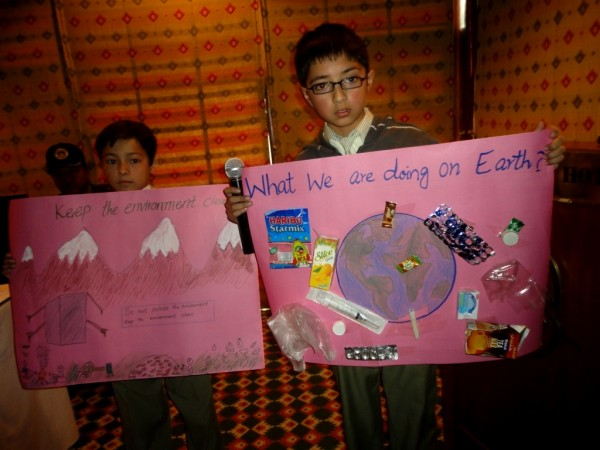 Children presenting their posters at a session in Gilgit Serena