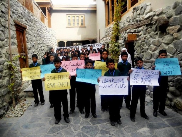 Students holding placards at the Khaplu Palace, Ghanche