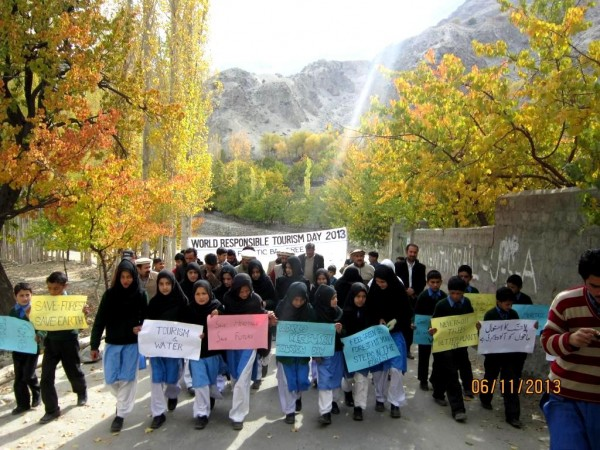 Girls in Khaplu, Ghanche, walk to raise awareness about the importance of responsible tourism