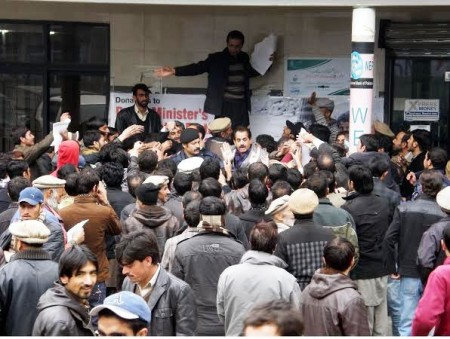 Gilgit: Loan applicants getting forms of the Prime Minister Scheme at NBP NLI Market Branch. Photo: Mon Shereen