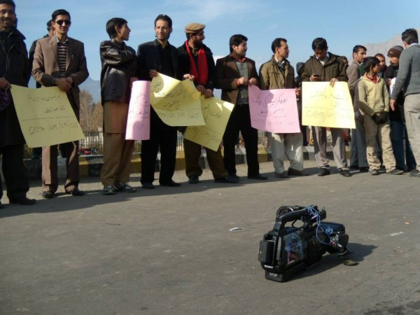 The local journalists staging a protest demonstration in front of Gilgit Airport. Ab Tak Photo