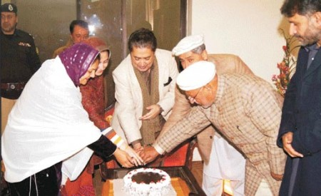 Governor and Chief Minister cutting a cake on the birthday of His Highness the Aga Khan