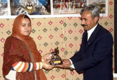 Babar of WWF presenting a souvenir to Sadia Danish, GB Information Minister
