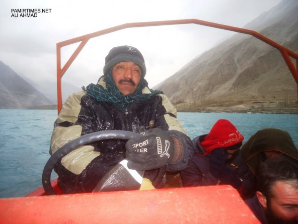 A boat operator braves the strong icy winds, taking dozens of passengers in open boat in which there are no safety equipment, to be used during any accident or emergencies