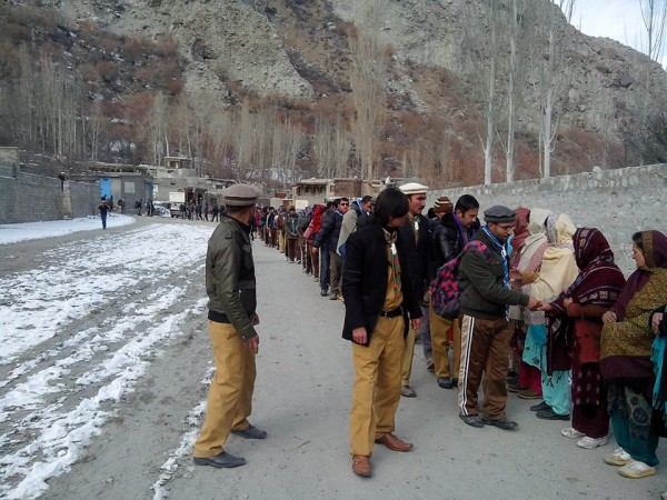Local men and women of Gojal Valley receive the hiking scouts in Gulmit