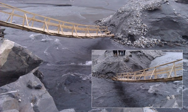 The collapsed bridge is being used by the pedestrians because they do not have any other option. This poses serious risk to life and limbs of the people