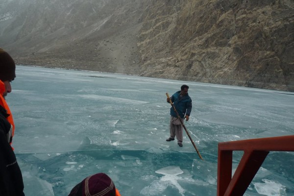 A man trying to break the surface to facilitate the boat's movement