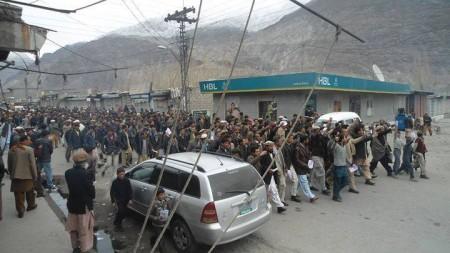 A rally marches through the Gahkuch bazar