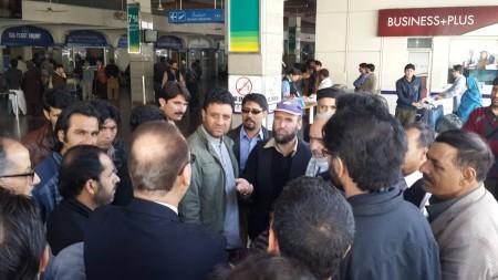 The passengers dispersed after assurance by PIA authorities. Photo: Zulfiqar Ali Khan