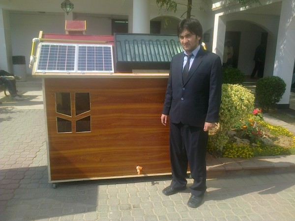 Hasnain, the team leader, standing in front of the model