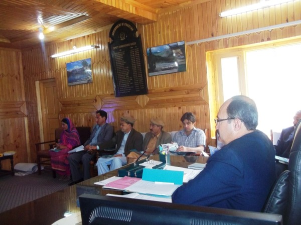 DC Ghizer Rasheed Ali is being briefed at his office in Gahkucch
