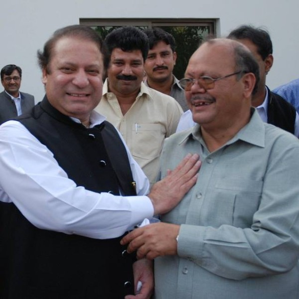 The Prime Minister sharing a light moment with Zulfiqar Balti
