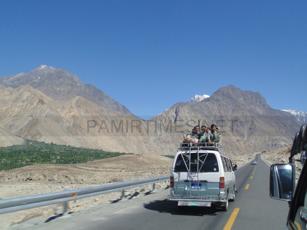 A van moving on the KKH carrying students on its roof. Photo: Javed Karim