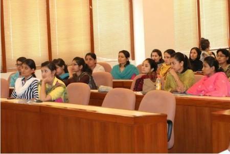 Participants carefully listen to the facilitators