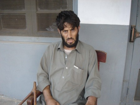 One of the accused murderers is in police custody