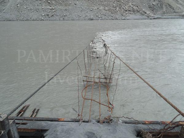 A partially resurfaced view of the suspension bridge in Gulmit