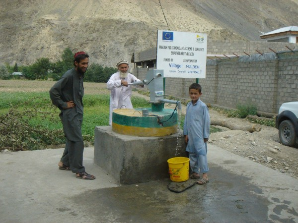 Locals have gathered at one of the wells dug by the SRSP