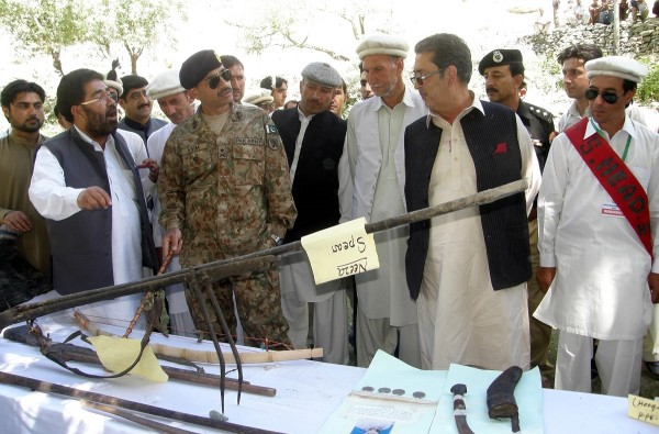 The guests are visiting a stall exhibiting ancient weapons