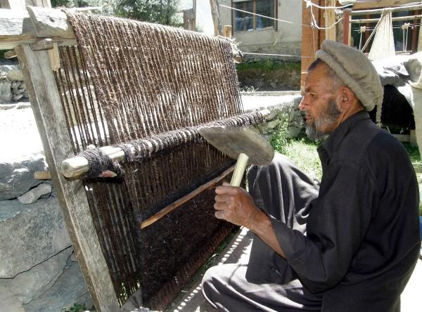 An artisan prepares a local carpet during the festival
