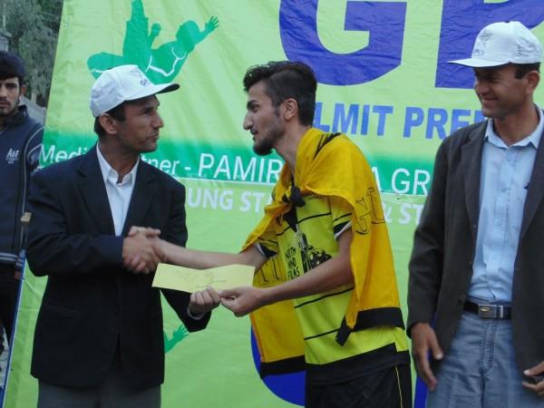 Kabir Ayub, Man of the final match, receiving his prize
