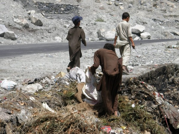 Some young kids can be seen picking garbage from the dump under highly unhygienic conditions . Photo: Farman Karim Baig