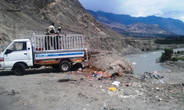 Gilgit: Some people are throwing trash in the river, close to the road that connects rest of Konodas with the area where the KIU campus is located