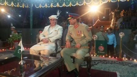 Chief Minister and FCNA Commander sharing the stage during the independence day parade. Photo: Khursheed Ahmed