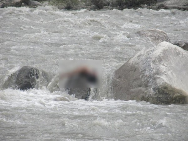 The blurred portion of the photograph hides the dead body of the man