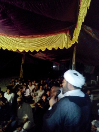 A speaker addresses the protesters during the night in Gilgit