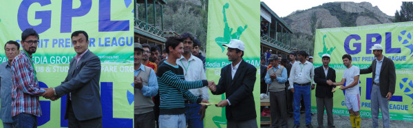 Zahir, Basit and Ahmed receiving their prizes from the guests