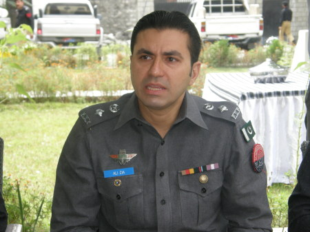 SP Zia Ali briefing media about the arrests at his office
