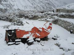 A truck covered with a tarpaulin after accident last winter