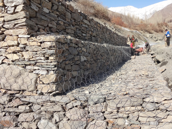 A layered embankment is being constructed to control land erosion