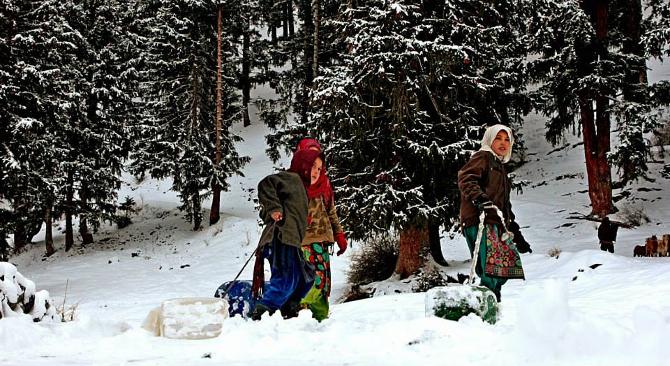 Life in the valley is difficult for the locals because of lack of facilities. Women, men and girls have to fetch water in the severe cold from sources located away from their houses. Photo: M Amin Zia