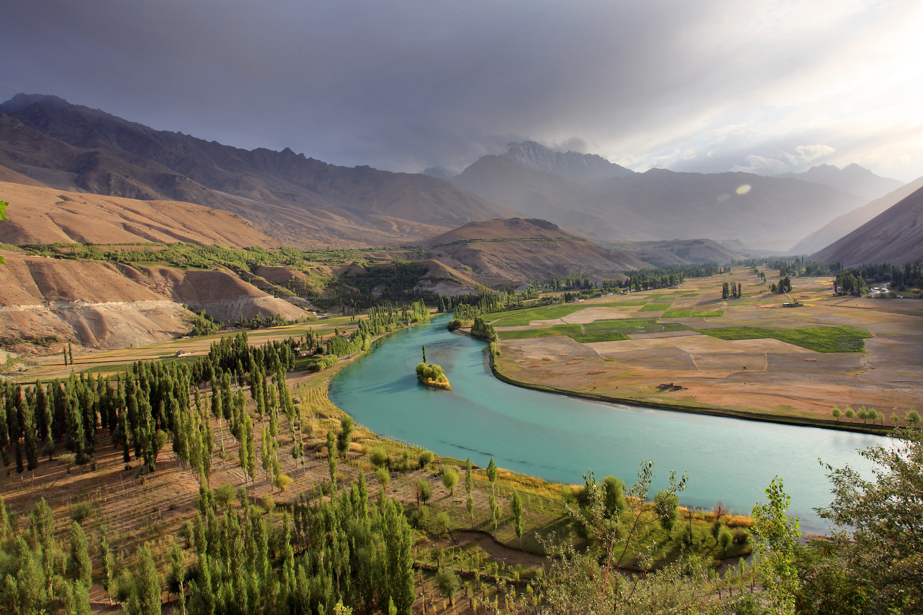 The turquoise Phandar river snakes through the valley