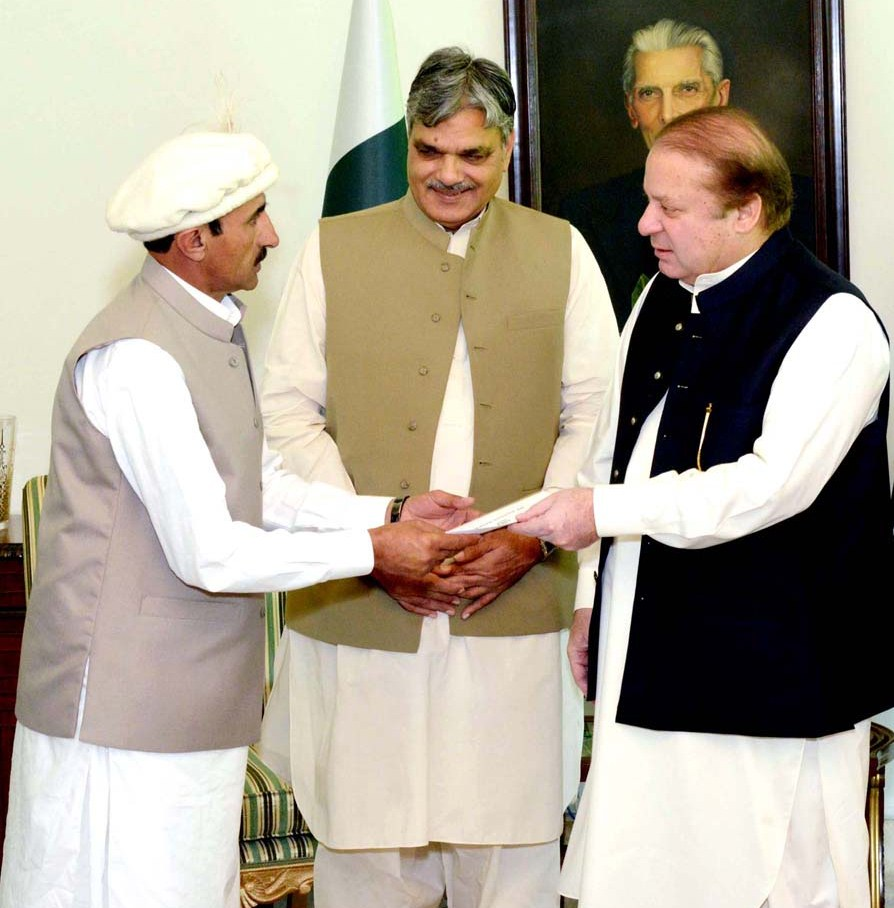 Prime Minister Muhammad Nawaz Sharif giving away a cheque of Rs. 5 million to a Pakistani mountaineer, Mr. Hassan Sadpara in recognition of his services for the promotion of mountaineering in Pakistan, at PM House, Islamabad on June 17, 2015.