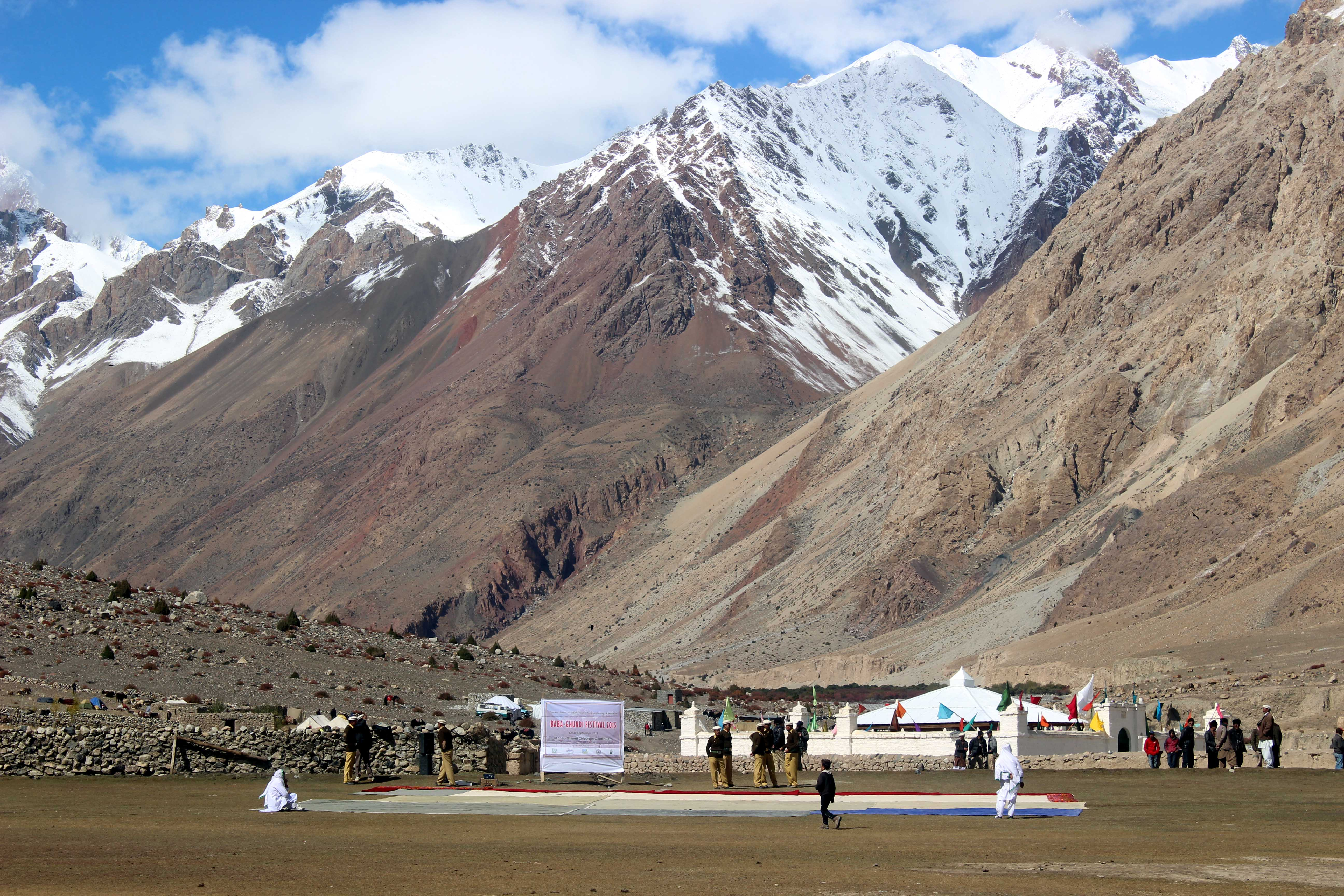 A view of the Baba Ghundi Shrine with a snow-capped mountain in the background