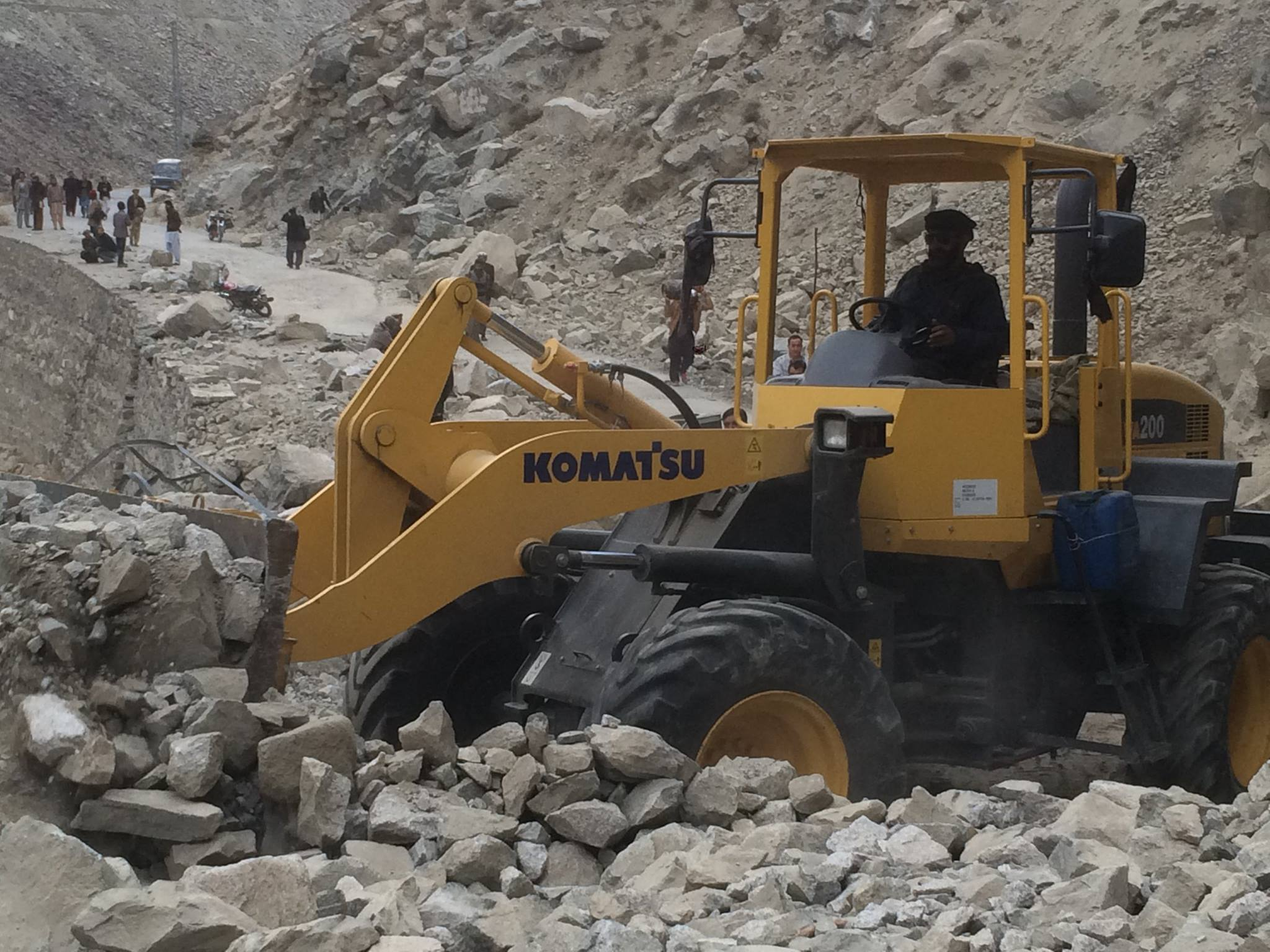 District officials busy repairing a road in Ghizar district