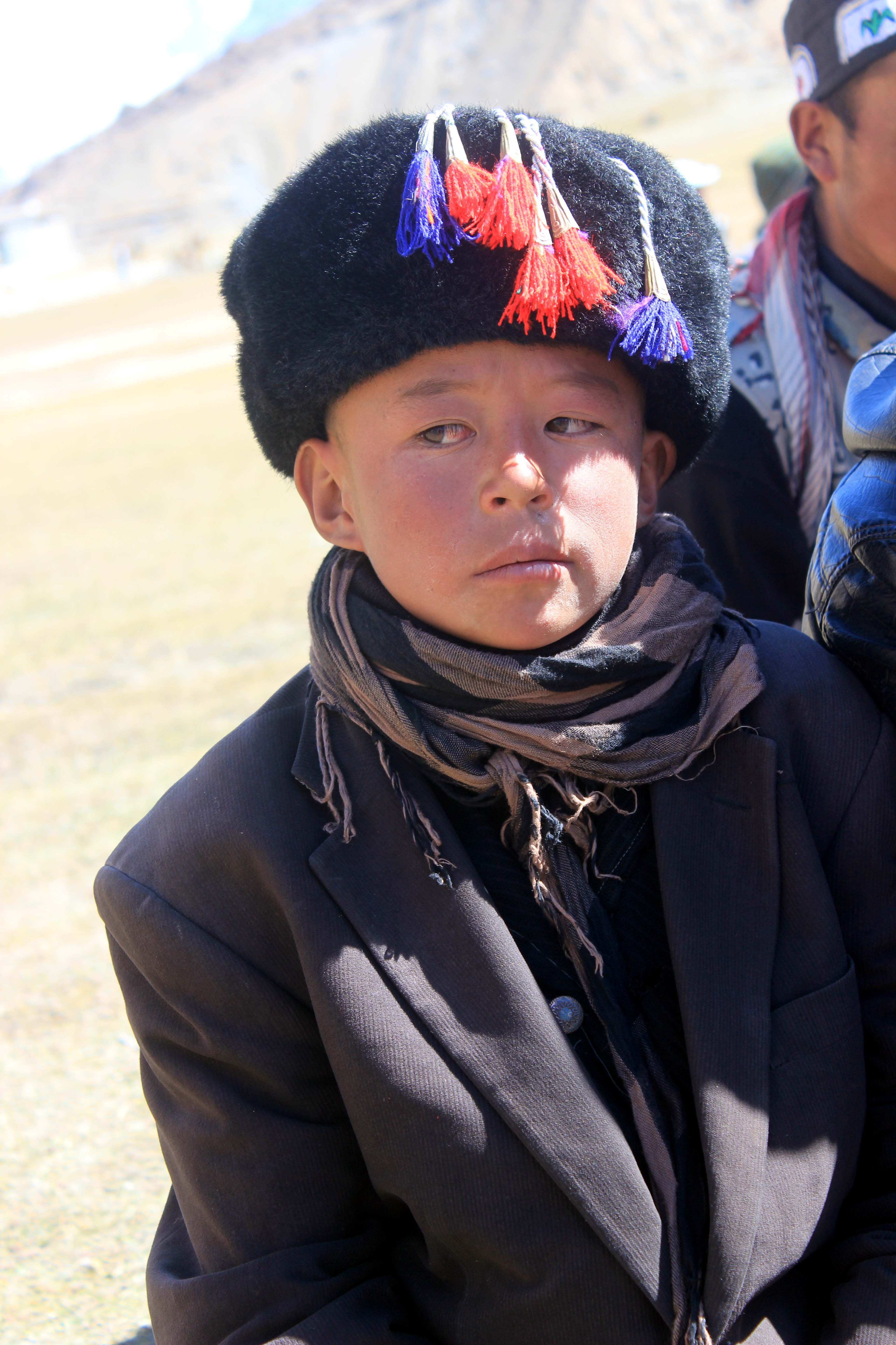A Kirghiz child who came to attend the festival with his parents