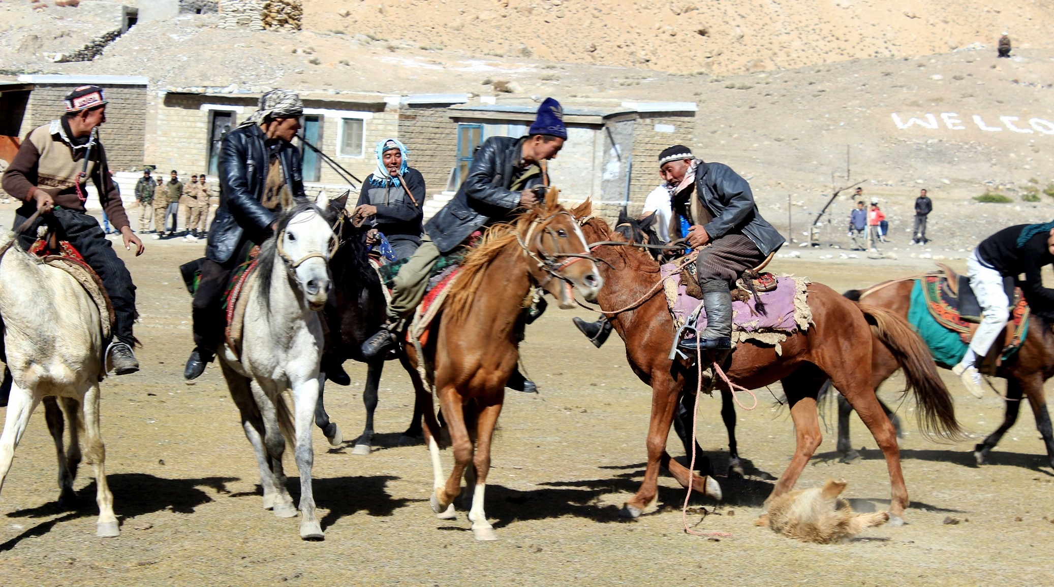 Players from the Wakhn region busy in playing Buzkashi, a traditional game played on horses
