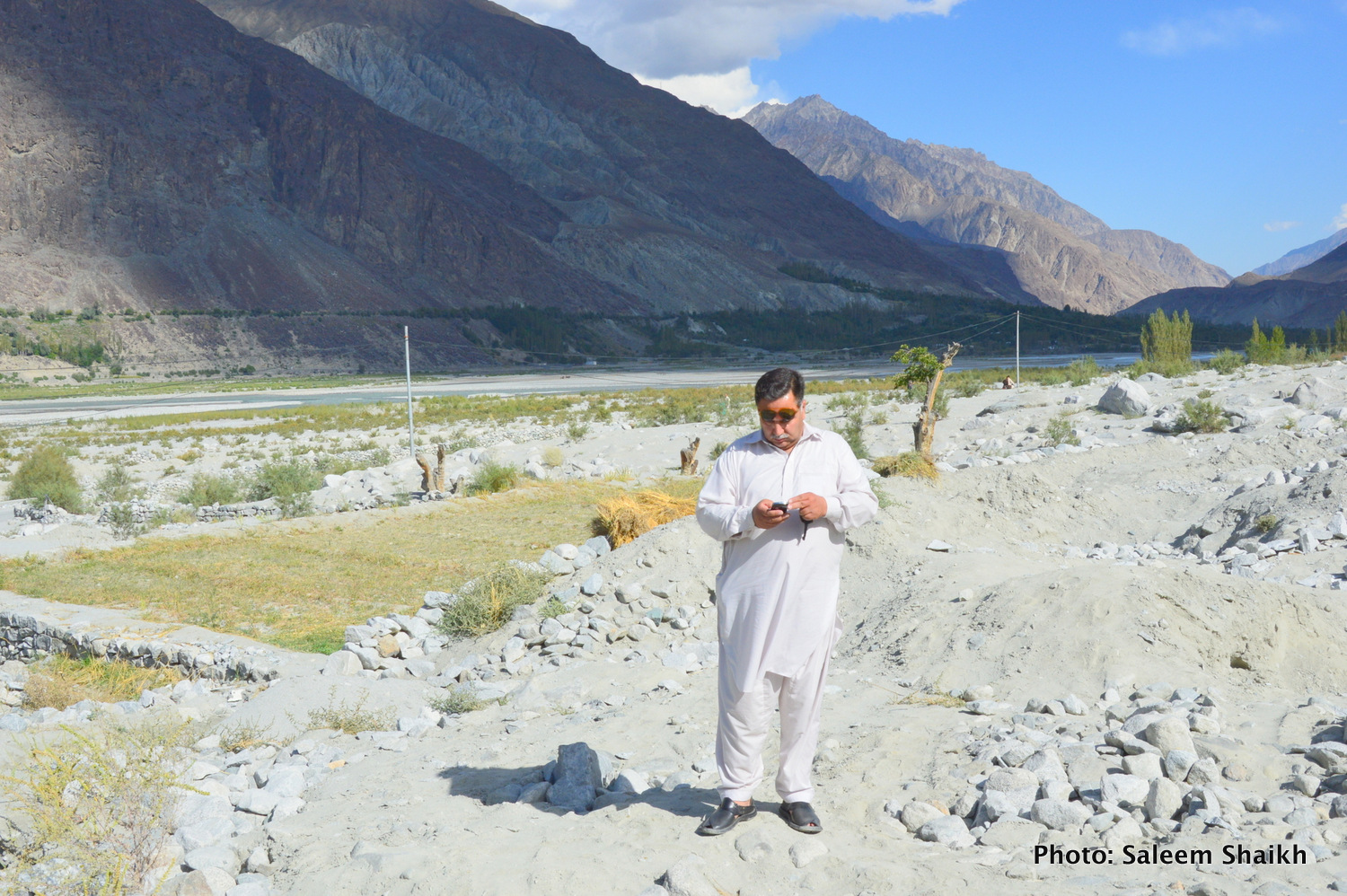 A farmer standing over what were once-fertile maize, potato and what fields now under the mud and heavy boulders washed down by the devastating 2010 flash flood in Damaas valley of Gilgit-Baltistan region's scenic Ghizer district, Pakistan's north. Photo credit: Saleem Shaikh