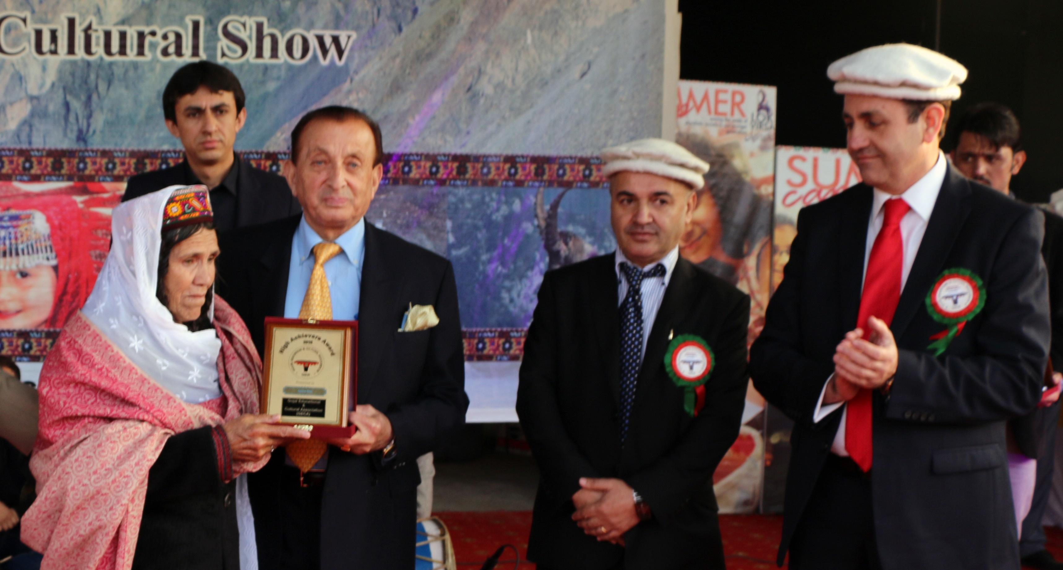 Islamabad: Mother of mountaineer Samina Baig receives an award on her daughter's behalf from Governor Mir Ghazanfar Ali Khan
